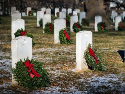 Wreaths placed on graves at a national cemetery in Virginia.
