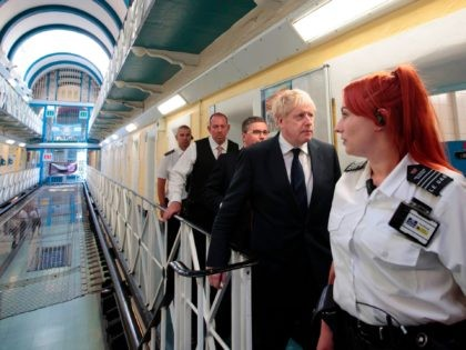 Britain's Prime Minister Boris Johnson (2R) talks with prison staff during a visit to HM Prison Leeds, a Category B men's prison in Leeds, northern England, on August 13, 2019. (Photo by Jon Super / POOL / AFP) (Photo credit should read JON SUPER/AFP via Getty Images)