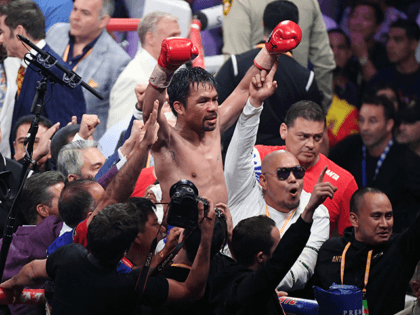 Manny Pacquiao celebrates his split-decision victory over Keith Thurman in their WBA welterweight title fight at MGM Grand Garden Arena on July 20, 2019 in Las Vegas, Nevada. (Photo by Ethan Miller/Getty Images)