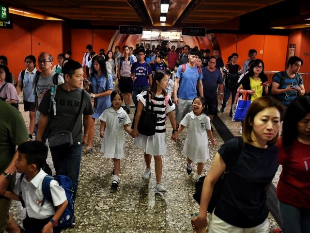 Commuters exit a train at the North Point MTR station in Hong Kong on September 2, 2019, after pro-democracy protesters caused more chaos on the underground rail system in the morning. - Pro-democracy campaigners have called for another general strike as the three-month movement shows no sign of letting up, …