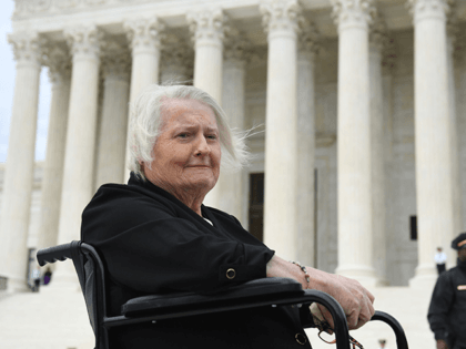 Transgender activist Aimee Stephens, sits in her wheelchair outside the US Supreme Court in Washington, DC, October 8, 2019, as the Court holds oral arguments in three cases dealing with workplace discrimination based on sexual orientation. - Thomas Rost, owner of RG & GR Harris Funeral Homes in Garden City, …