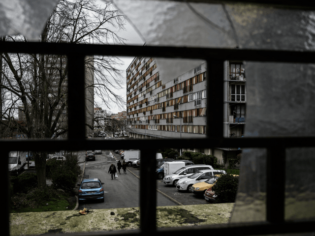 A man walks in a street of the social housing complex of the Chêne-Pointu, in Clichy-sous-Bois, in the suburbs of the French capital Paris on February 4, 2020. - Most of the residents of the 'Chêne-Pointu' housing estate did not see the film that was shot in front of their …