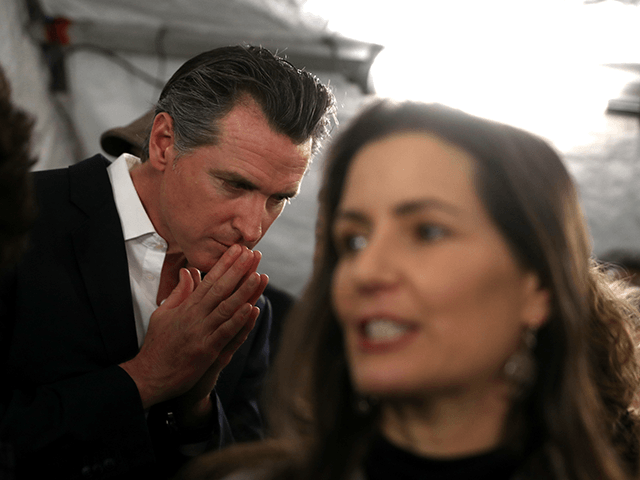 California Gov. Gavin Newsom (L) and Oakland Mayor Libby Schaaf (R) talk with reporters after a news conference about the state's efforts on the homelessness crisis on January 16, 2020 in Oakland, California. Newsom was joined by Schaaf to announce that Oakland will receive 15 unused FEMA trailers for the …