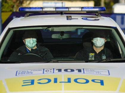 WOLVERHAMPTON, ENGLAND - APRIL 07: Police officers wear facial masks as they patrol during the pandemic lockdown on April 07, 2020 in Wolverhampton, United Kingdom. There have been around 50,000 reported cases of the COVID-19 coronavirus in the United Kingdom and 5,000 deaths. The country is in its third week …