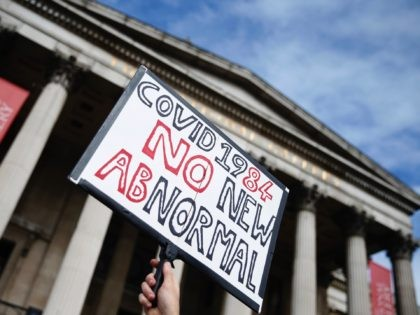 "LONDON, ENGLAND - SEPTEMBER 26: Demonstrators attend a ""We Do Not Consent"" anti-mask rally at Trafalgar Square on September 26, 2020 in London, England. Thousands of anti-mask demonstrators protested in Trafalgar Square after the British government imposed tighter coronavirus laws this week. (Photo by Hollie Adams/Getty Images)"