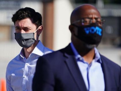 LITHONIA, GA - OCTOBER 03: Democratic U.S. Senate candidates Jon Ossoff and Rev. Raphael Warnock are seen at a campaign event on October 3, 2020 in Lithonia, Georgia. The two are hoping to unseat incumbent Senators David Perdue and Kelly Loeffler. (Photo by Elijah Nouvelage/Getty Images)