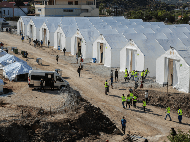A picture taken on October 14, 2020 shows the Kara Tepe camp for refugees and migrants on the island of Lesbos. - Greece will build a new permanent camp on the island of Lesbos next year to replace the facility that burned down last month, the migration minister said October …