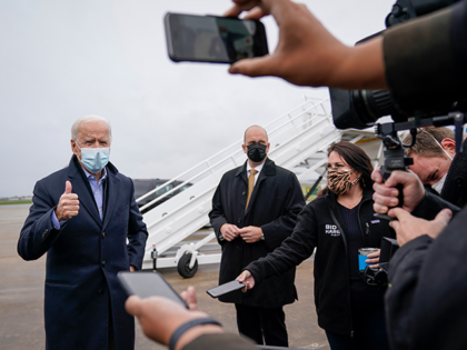 Democratic presidential nominee Joe Biden speaks to reporters before boarding his campaign plane at New Castle Airport on October 30, 2020 in New Castle, Delaware. Biden is campaigning in Iowa, Wisconsin and Minnesota on Friday. (Photo by Drew Angerer/Getty Images)