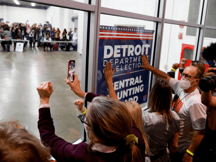 Supporters of US President Donald Trump bang on the glass and chant slogans outside the room where absentee ballots for the 2020 general election are being counted at TCF Center on November 4, 2020 in Detroit, Michigan. - Democratic presidential challenger Joe Biden on November 4 neared the magic number …