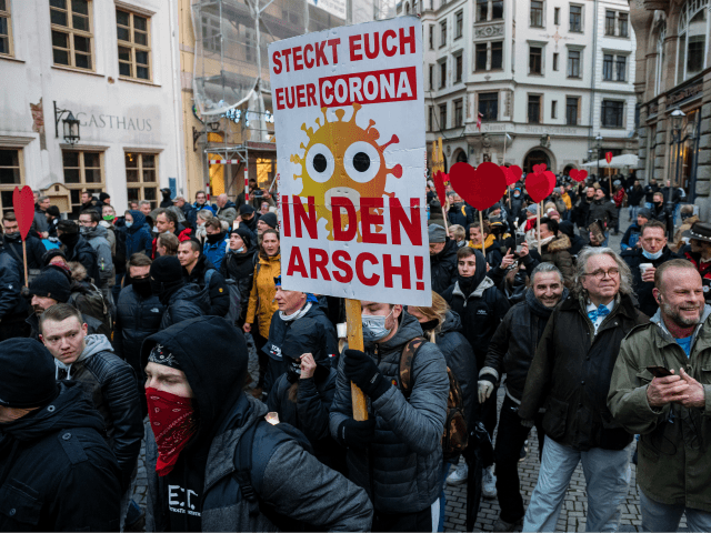 LEIPZIG, GERMANY - NOVEMBER 21: People gather to protest against coronavirus lockdown measures during the second wave of the pandemic on November 21, 2020 in Leipzig, Germany. The demonstration, which includes a range of protesters including neo-Nazis, hooligans, conspiracy theory activists and ordinary citizens, comes on the heels of a …