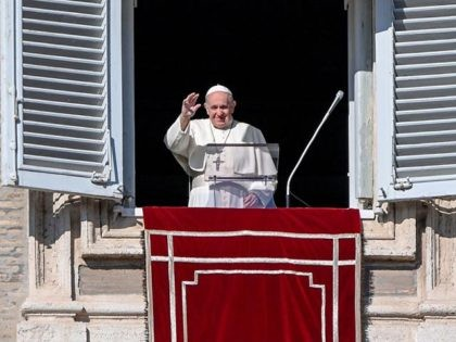 Pope Francis waves to worshippers as he arrives to deliver his weekly Angelus prayer on November 22, 2020 from the window of the apostolic palace overlooking St. Peter's Square in The Vatican. (Photo by Vincenzo PINTO / AFP) (Photo by VINCENZO PINTO/AFP via Getty Images)
