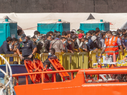 A group of migrants arrive at the Port of Arguineguin after being rescued by the Spanish coast guard in the Canary Island of Gran Canaria on November 23, 2020. - Arrivals of migrants have soared in Spain's Canary Islands with more than 18,000 arriving from Africa so far this year, …