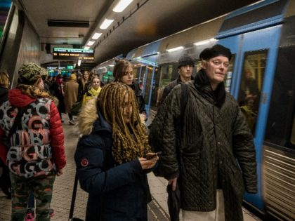 STOCKHOLM- SWEDEN - DECEMBER 4: Passengers are waiting on the platform at the T-centralen station to board the metro on December 4, 2020 in Stockholm, Sweden. Despite government guidelines regarding social distancing and avoiding large crowds, the metro stations are full of passengers crowded on the platforms. Over 7,000 people …