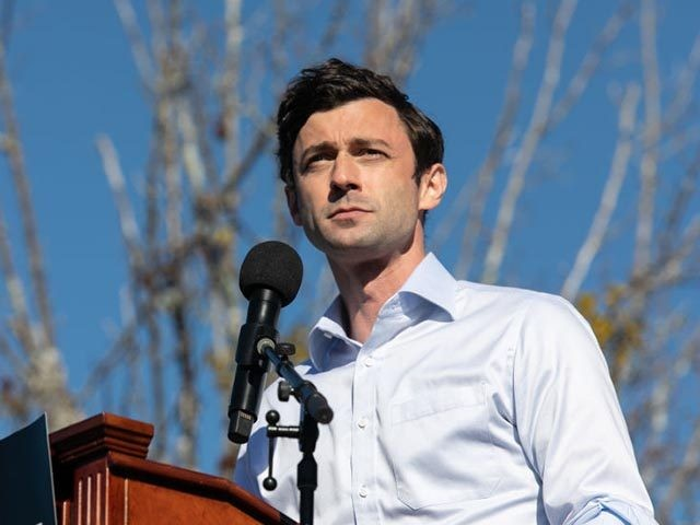 CONYERS, GA - DECEMBER 05: Democratic U.S. Senate candidate Jon Ossoff speaks to the crowd during an outdoor drive-in rally on December 5, 2020 in Conyers, Georgia. Ossoff will face Republican incumbent Sen. David Purdue (R-GA) in a runoff election that will take place January 5th. (Photo by Jessica McGowan/Getty …