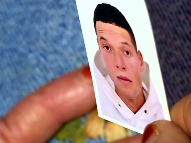 This image grab from AFP TV shows a picture of Nice assailant Brahim Aouissaoui, who a day earlier killed three people and wounded several others in the southern French city of Nice, held by his mother at the family home in the Tunisian city of Sfax, on October 30, 2020. …