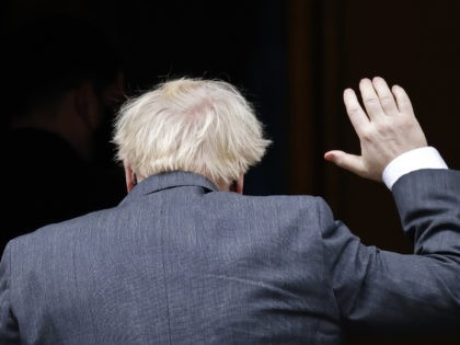 Britain's Prime Minister Boris Johnson waves as he returns to 10 Downing Street in central London on December 9, 2020, after taking part in the weekly session of Prime Minister Question (PMQs) at the House of Commons. - British Prime Minister Boris Johnson and European Commission president Ursula von der …