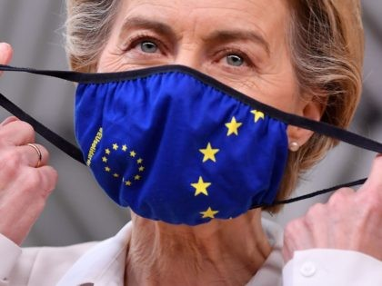 President of the European Commission Ursula von der Leyen takes of her face mask before addressing journalists as she arrives at the EU headquarters' Europa building in Brussels on December 10, 2020, prior to a European Union summit. (Photo by JOHN THYS / POOL / AFP) (Photo by JOHN THYS/POOL/AFP …