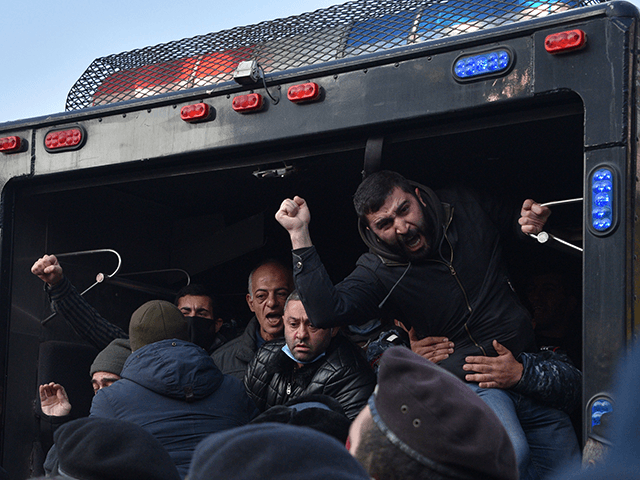 Police officers detain protesters during a rally to demand the resignation of Prime Minister Nikol Pashinyan over a controversial peace agreement with Azerbaijan that ended six weeks of war over the disputed region of Nagorno-Karabakh, in Yerevan on December 11, 2020. - Under the deal, Armenia agreed to cede three …