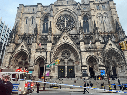 Police are seen outside of the Cathedral of St. John the Divine in New York on December 13, 2020, after a shooter opened fire outside the church before police returned fire and took the man into custody. (Photo by Eleonore SENS / AFP) (Photo by ELEONORE SENS/AFP via Getty Images)