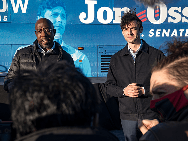 Democratic Candidate for U.S. Senate Jon Ossoff and Rev. Raphael Warnock speak at a campaign event to encourage people to vote on December 14, 2020 in Atlanta, Georgia. Today was the first day of early voting for the runoff election between Ossoff and Sen. David Perdue (R-GA) and Warnock and …