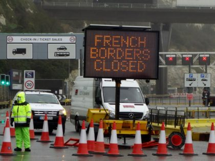 "A sign alerts customers that the ""French Borders are Closed"" at the entrance to the Port of Dover in Kent, south east England on December 21, 2020, as a string of countries banned travellers all but unaccompanied freight arriving from the UK, due to the rapid spread of a more-infectious …"