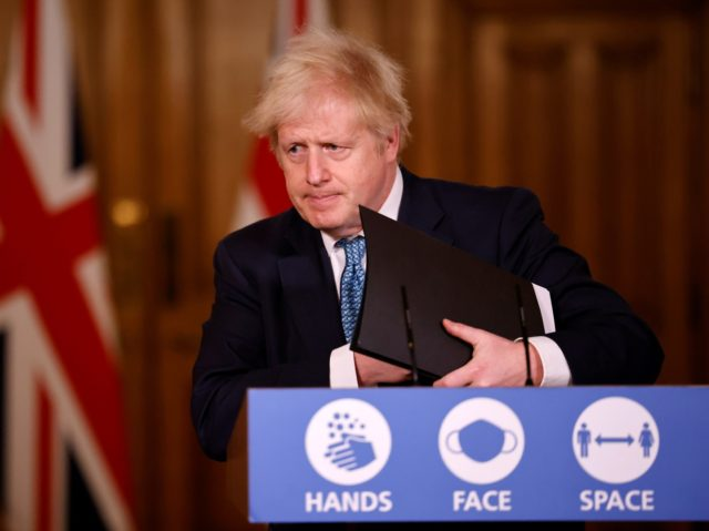 LONDON, ENGLAND - DECEMBER 21: Britain's Prime Minister, Boris Johnson speaks during a virtual press conference inside 10 Downing Street after a string of countries banned travellers and all but unaccompanied freight arriving from the UK, due to the rapid spread of a new, more-infectious coronavirus strain on December 21, …