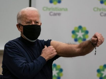 US President-elect Joe Biden holds out his arm after receiving a Covid-19 vaccination at the Christiana Care campus in Newark, Delaware on December 21, 2020. (Photo by ALEX EDELMAN / AFP) (Photo by ALEX EDELMAN/AFP via Getty Images)