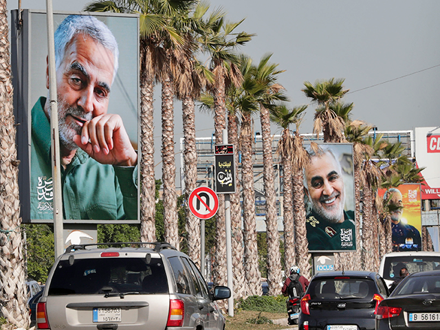 The highway leading the Lebanese capital Beirut to the southern areas of the city is pictured ahead of the first anniversary of the killing of Iranian Revolutionary Guards commander Qasem Soleimani (portrait), on December 31, 2020 in Beirut. - On January 3, Iraq will mark a year since a US …