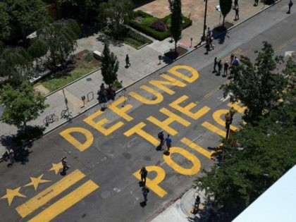 "WASHINGTON, DC - JUNE 08: People walk down 16th street after ""Defund The Police"" was painted on the street near the White House on June 08, 2020 in Washington, DC. After days of protests in DC over the death of George Floyd, DC Mayor Muriel Bowser has renamed that section …"