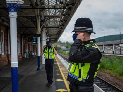 STALYBRIDGE, ENGLAND - JULY 04: Police Officers and security guards patrol outside Stalybridge Buffet Bar, situated on the platform at Stalybridge Train Station, which usually receives a large amount of custom from rail passengers heading into Manchester on July 04, 2020 in Stalybridge, England. The UK Government announced that Pubs, …