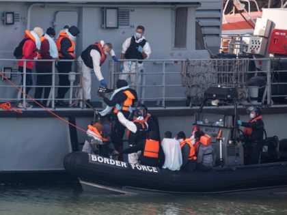 DOVER, ENGLAND - SEPTEMBER 22: Border Force officials unload migrants, that have been intercepted in the English Channel, in order to process them on September 22, 2020 in Dover, England. This summer has seen an increase in people making the journey in small crafts from France seeking asylum in U.K. …