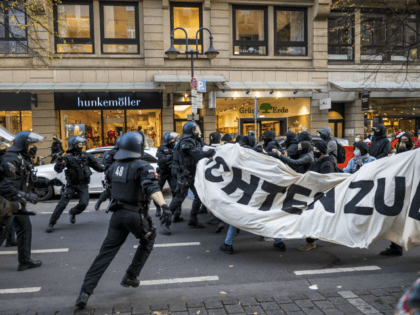 FRANKFURT AM MAIN, GERMANY - NOVEMBER 14: Police clash with left-wing antifa counter-demonstrators protesting against a demonstration of the Querdenker movement on November 14, 2020 in Frankfurt, Germany. Some hundreds of demonstrators gather to protest against coronavirus lockdown restrictions Police, who have in the past looked on without strongly intervening …