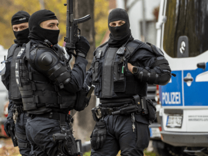 BERLIN, GERMANY - NOVEMBER 17: Heavily-armed police stand outside a street near to an apartment building in Neukoelln district during raids in which police arrested three suspects in connection with last year's spectacular robbery in the Gruenes Gewoelbe museum in Dresden on November 17, 2020 in Berlin, Germany. On November …