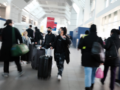 People walk through New York's LaGuardia Airport on November 24, 2020 in New York City. Despite warnings from the government and politicians not to travel for the Thanksgiving holiday due to the Covid-19 pandemic, millions of Americans have been flying and driving to meet friends and family for the holiday. …