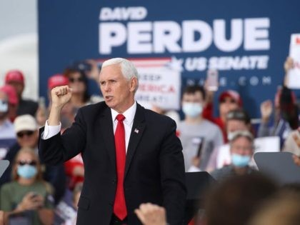 SAVANNAH, GEORGIA - DECEMBER 04: U.S. Vice President Mike Pence attends a rally in support of Sen. David Perdue (R-GA) and Sen. Kelly Loeffler (R-GA) on December 04, 2020 in Savannah, Georgia. The Defend the Majority Rally with the senators comes ahead of a crucial runoff election for Perdue and …
