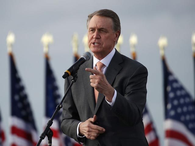 SAVANNAH, GEORGIA - DECEMBER 04: Sen. David Perdue (R-GA) attends a rally with Vice President Mike Pence in support of both he and Sen. Kelly Loeffler (R-GA) on December 04, 2020 in Savannah, Georgia. The Defend the Majority Rally with the senators comes ahead of a crucial runoff election for …