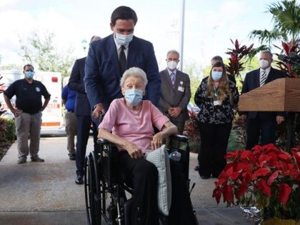 POMPANO BEACH, FLORIDA - DECEMBER 16: Florida Gov. Ron DeSantis pushes Vera Leip, 88, in her wheelchair after she received a Pfizer-BioNtech COVID-19 vaccine at the John Knox Village Continuing Care Retirement Community on December 16, 2020 in Pompano Beach, Florida. The facility, one of the first in the country …