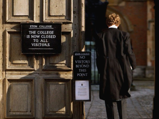 ETON, ENGLAND - MARCH 1: Pupil at Eton College hurries between lessons, March 1, 2004 wearing the school uniform of tailcoats and starched collars, in Eton, England. Dozens of the country's foremost independent schools are facing heavy fines if a government inquiry finds them guilty of operating a fee-fixing cartel. …