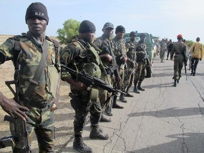 This photo taken on June 17, 2014 in Dabanga, northern Cameroon, shows Cameroon's army soldiers deploying as part of a reinforcement of its military forces against Nigerian Islamist group Boko Haram. Boko Haram, which in April 2014 kidnapped more than 200 schoolgirls in northeast Nigeria to international condemnation, has been …