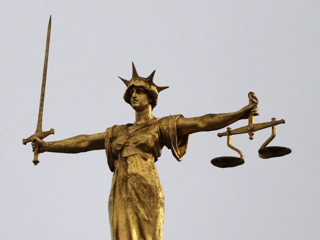 LONDON, ENGLAND - FEBRUARY 16: A statue of the scales of justice stand above the Old Bailey on February 16, 2015 in London, England. (Photo by Dan Kitwood/Getty Images)
