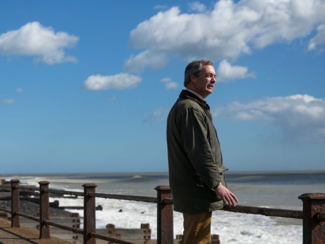 DOVER, ENGLAND - MARCH 31: Nigel Farage, leader of the U.K. Independence Party (UKIP) poses along a footpath under the White Cliffs of Dover on March 31, 2015 in Dover, England. UKIP unveiled their latest election political campaign poster today, aimed at issues of reducing immigration. (Photo by Dan Kitwood/Getty …