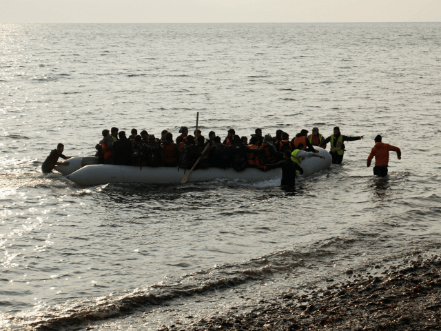 Refugees and migrants on a rubber boat arrive at the Greek island of Lesbos early on March 20, 2016. Greece will not be able to start sending refugees back to Turkey from March 20, 2016, the government said, as the country struggles to implement a key deal aimed at easing …