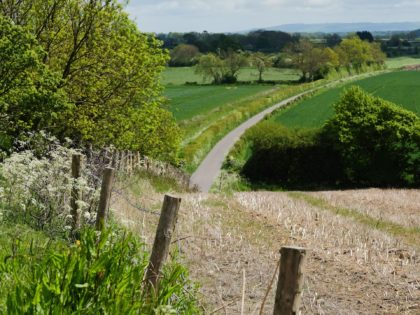 MALTON, ENGLAND - MAY 24: A road meanders through the countryside on the approach to the village of Kirby Misperton on May 24, 2016 in Malton, England. North Yorkshire Planning and Regulatory Committee voted seven to four in favour of a planning application submitted by Third Energy to conduct fracking …