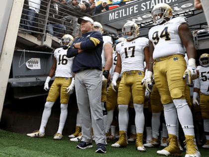 Head coach Brian Kelly of the Notre Dame Fighting Irish and his team wait to head on to the field for the start of the game against the Syracuse Orange at MetLife Stadium on October 1, 2016 in East Rutherford, New Jersey. (Photo by Elsa/Getty Images)