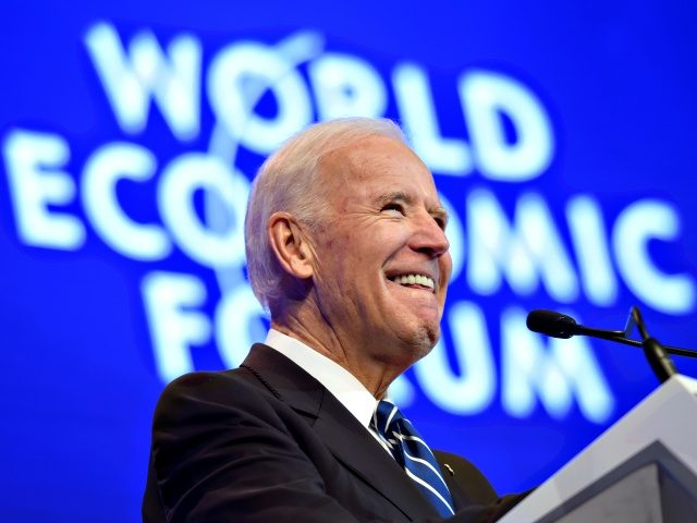 Outgoing US vice president Joe Biden arrives on stage to address the assembly on the second day of the World Economic Forum, on January 18, 2017 in Davos. - With the world's elite holding its breath until Donald Trump becomes the next US president, outgoing Vice-President Joe Biden addresses the …