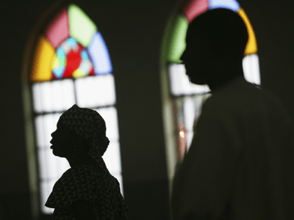Nigerian Catholic worshippers stand during morning mass April 12, 2005 in Kano, Nigeria. Kano is part of Nigeria's primarily Muslim north, but devoted Catholic minority participates in frequent Masses in local cathedrals. Cardinal Francis Arinze of Nigeria is considered a leading contender to become pope in the aftermath of the …