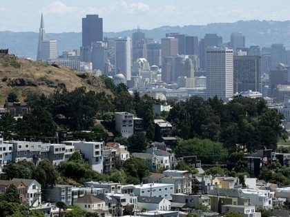 SAN FRANCISCO - JUNE 06: Rows of houses stand in front of the San Francisco skyline June 6, 2007 in San Francisco, California. The National Association of Realtors announced today that it is lowering its forecast of the U.S. housing market as home sales continue to be weak. The NAR …
