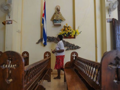 A Catholic faithful prays at Jovellanos' Church, Matanzas province, Cuba on August 9, 2017. / AFP PHOTO / YAMIL LAGE (Photo credit should read YAMIL LAGE/AFP via Getty Images)