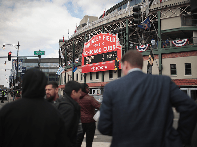 Ticket sellers try to unload the last of their discounted game tickets across from Wrigley Field during the Chicago Cubs home opener on April 10, 2018 in Chicago, Illinois. The game against the Pittsburgh Pirates was originally scheduled for yesterday but was delayed due to snow. (Photo by Scott Olson/Getty …