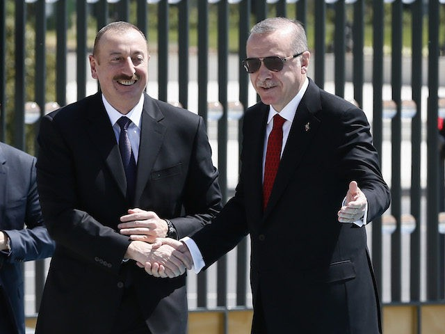 ANARKA, TURKEY - APRIL 25: In this handout photo provided by The Turkish President Press office, Turkish President Recep Tayyip Erdogan (R) with Ilham Aliyev, President of the Republic of Azerbaijan (L) at Turkish Presidental Palace in on Apil 25, 2018 in Ankara, Turkey. (Photo by Turkish President Press Office …